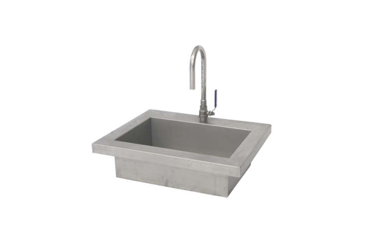 Sold as a unit, the Dutch outdoor kitchen design company WWOO makes a stainless steel sink that comes with their own outside tap (the WWOO Buitenkraan). Together the two are €699 at WWOO.