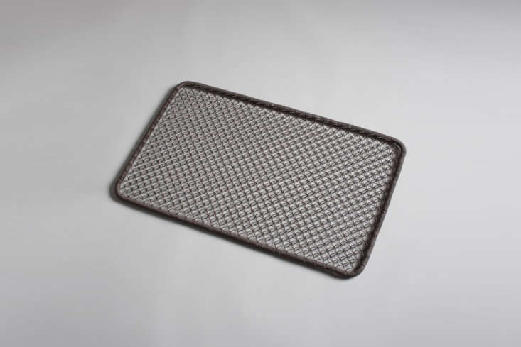 A Wire Doormat made of brown-tinted looped metal is \$58 at Burkelman.