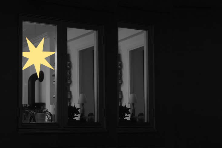 A lighted holiday star in a window in Stockholm, Sweden. Photograph by Bengt Nyman via Flickr.