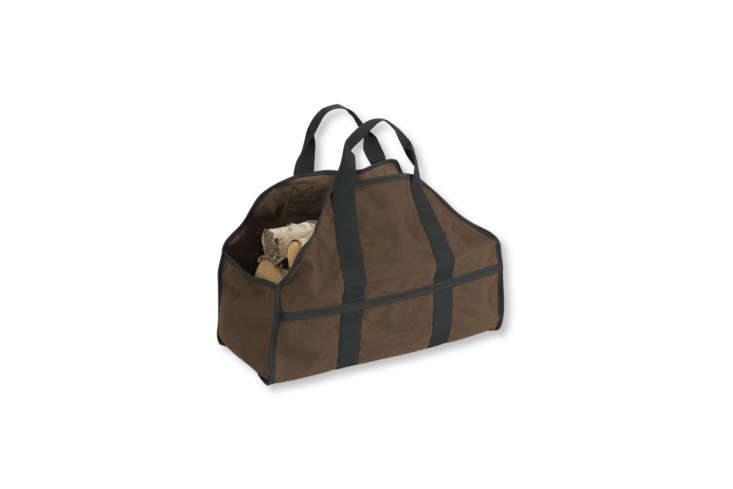 A Dura-Tough Standing Log Carrier, made of canvas, is $39.95 from L.L. Bean.