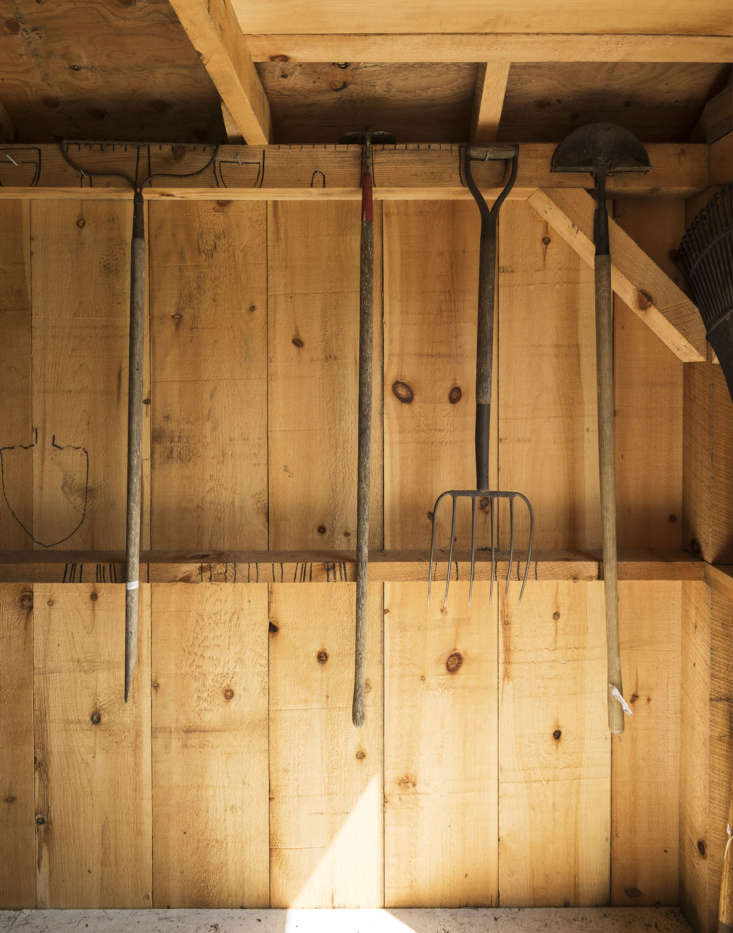 Long-handled tools hang from the rafters.