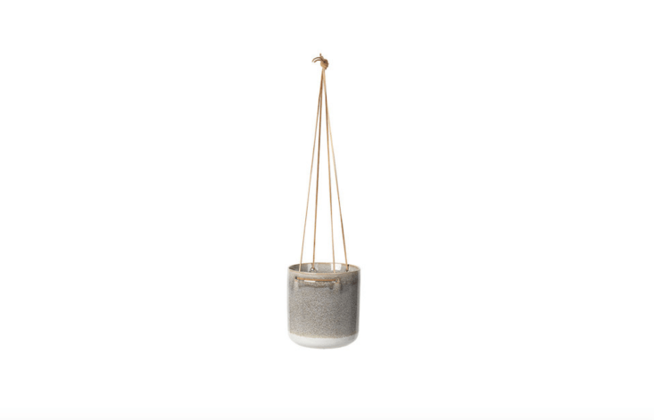 A textured ceramic Almas Hanging Flowerpot has a leather string (and is suitable for outdoor use in summer months). It is \$48 from Amara.