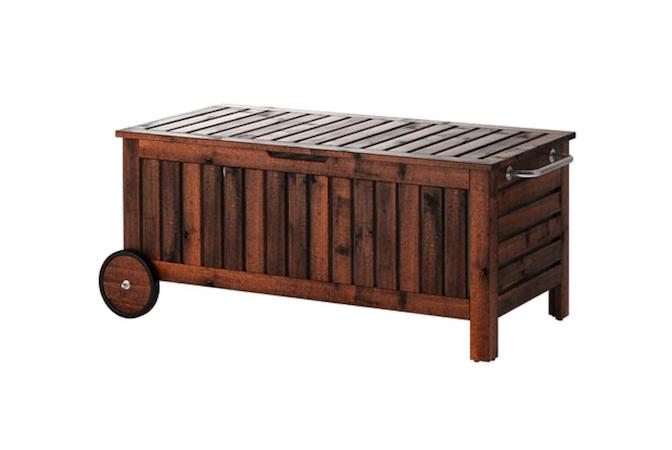 Ikea adds wheels: thank you. An Äpplarö outdoor storage bench is portable; \$\1\29.
