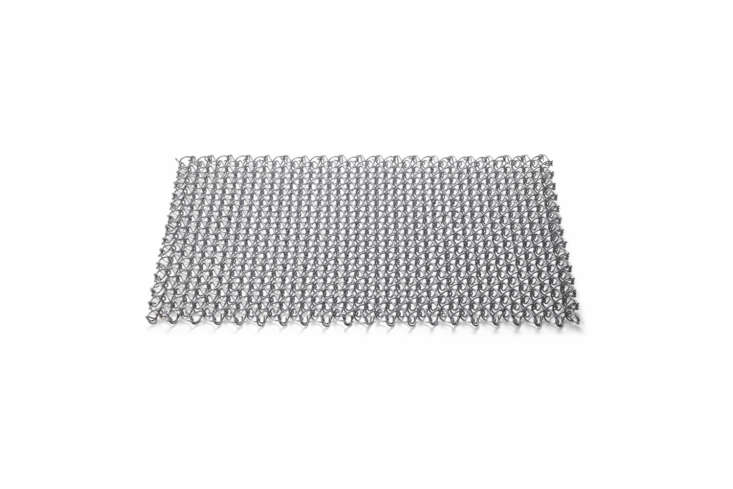 A Door Mat made of galvanized wire designed to age and darken over time; €.50 at Manufactum in Germany.