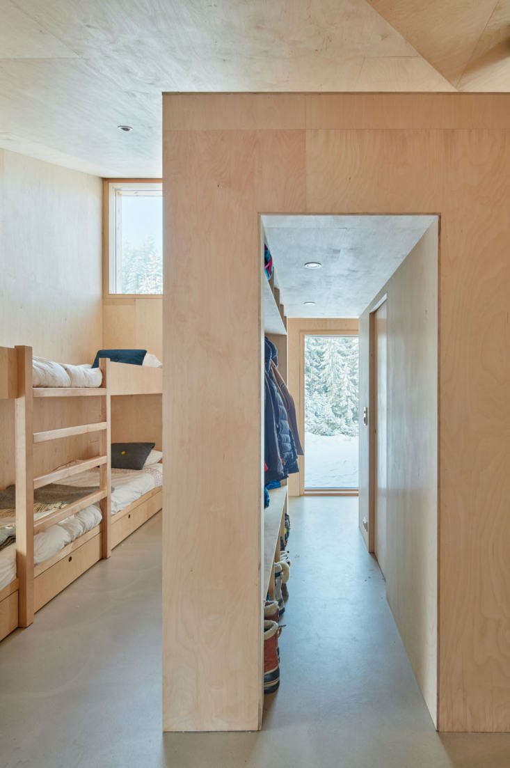 Windows in the bunkroom frame the woodland views. &#8\2\20;The wings of the house engage four distinct characters of the site: the great room looks onto Mylla Lake, the guest room looks towards the rolling hillside, the kids' room looks up at the sky, and the bedroom has a private view of the towering forest,&#8\2\2\1; the architects say.
