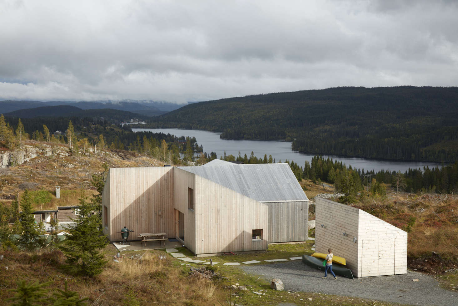 The exterior is sided with untreated pine and the roof also is clad in wood.