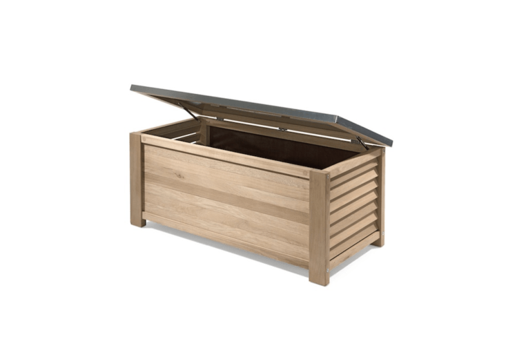Open slats on an oak Garden Chest improve air circulation for stored items. Covering the lid is a waterproof zinc sheet; €\1,\269 from Manufactum.
