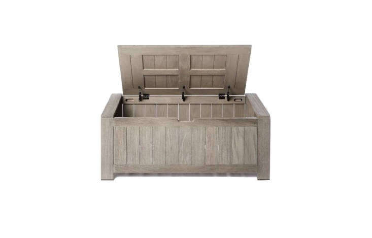 A weathered gray finish fades into the background. A Portside Outdoor Storage Trunk made of sustainably sourced solid wood with a wire-brushed surface is \$559 from West Elm.