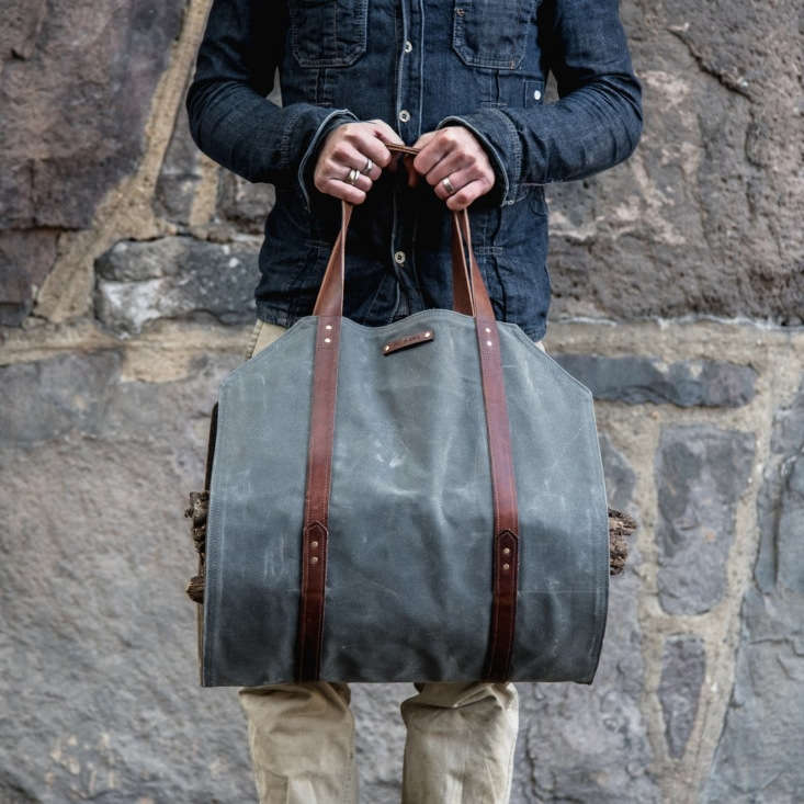 The Shanty Man Log Carrier is made of waxed canvas and leather straps from dead stock WWII leather gun slings. Brass grommets lend an extra layer of support;  inches wide by 38 inches long and $