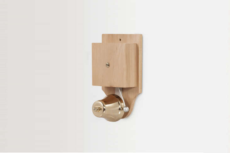 The Wired Wall-Mounted Retro Striker Doorbell in brass and light wood is a \19\20s replica; £39.95 at Doorbell World in the UK.