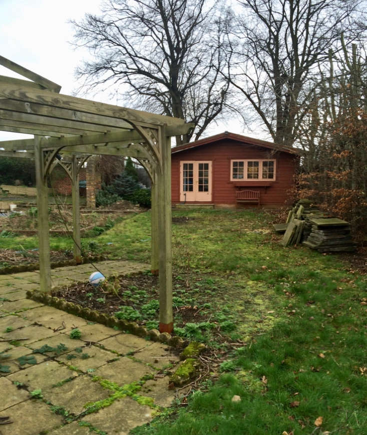 An existing summer house anchored one area of the garden.