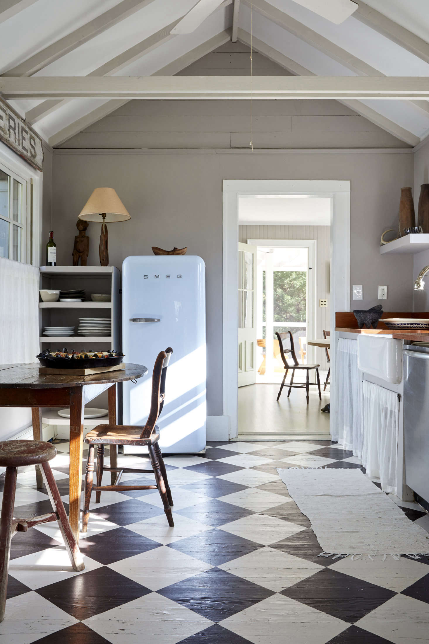 One of our favorite farmhouse kitchens ever. Photograph by Dana Gallagher, styling by Hilary Robertson, from Steal This Look: An Antique Dealer's DIY Kitchen, Painted Checkerboard Floor Included.