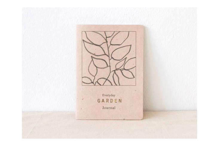 The handmade Everyday Garden Journal by Atelier Arminho features recycled paper and gold foil print; $loading=