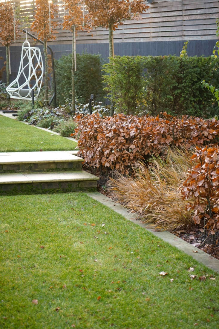 Sawn sandstone edges the lawn; for similar stone, see CED Stone Group.