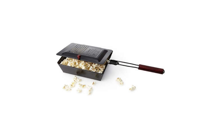 The Outdoor Popcorn Popper makes 3 quarts of popcorn in 4 to 5 minutes over a campfire or charcoal or gas grill; \$\17 at Uncommon Goods.