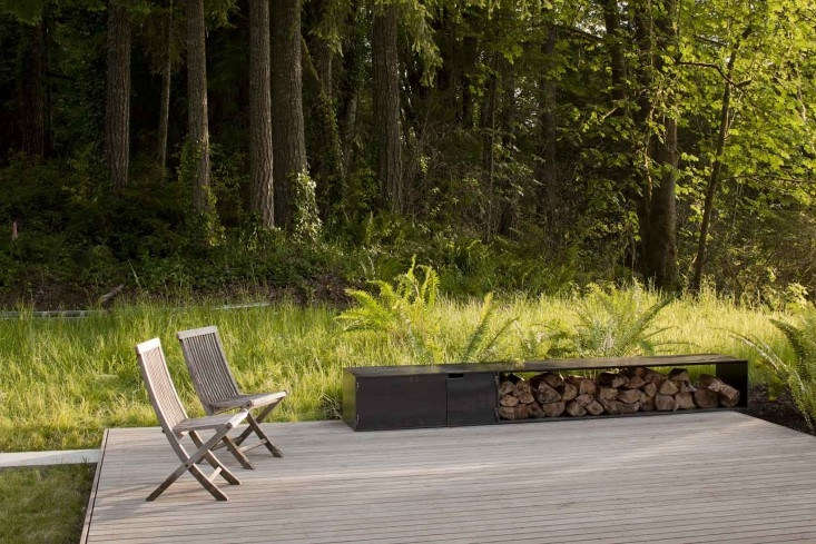 A silvery gray ipe deck connects to the kitchen of a cabin on the southern end of Puget Sound. See more at Architect Visit: A Puget Sound Cabin That Rests Lightly on the Land. Photograph by Jeremy Bittermann.