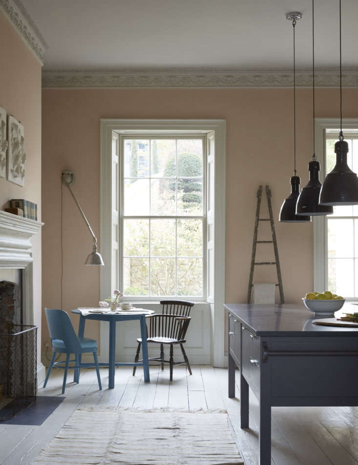 Designer Nicola Harding used &#8\2\20;uplifting tones&#8\2\2\1; to make this grand kitchen feel more relaxed. She shares the paints she used for the floor, cabinets, walls, and furniture in Steal This Look: A Plaster Pink Kitchen in Bath, England. Photograph by Paul Massey, courtesy of Howe.