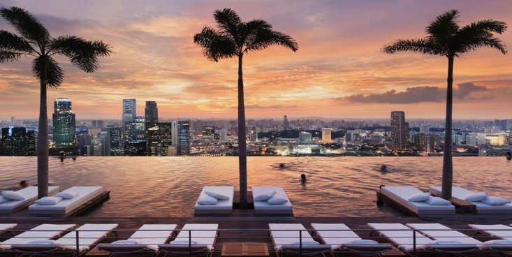 At the Marina Bay Sands in Singapore, a rooftop swimming pool is 57 floors above street level and has a panoramic city view.