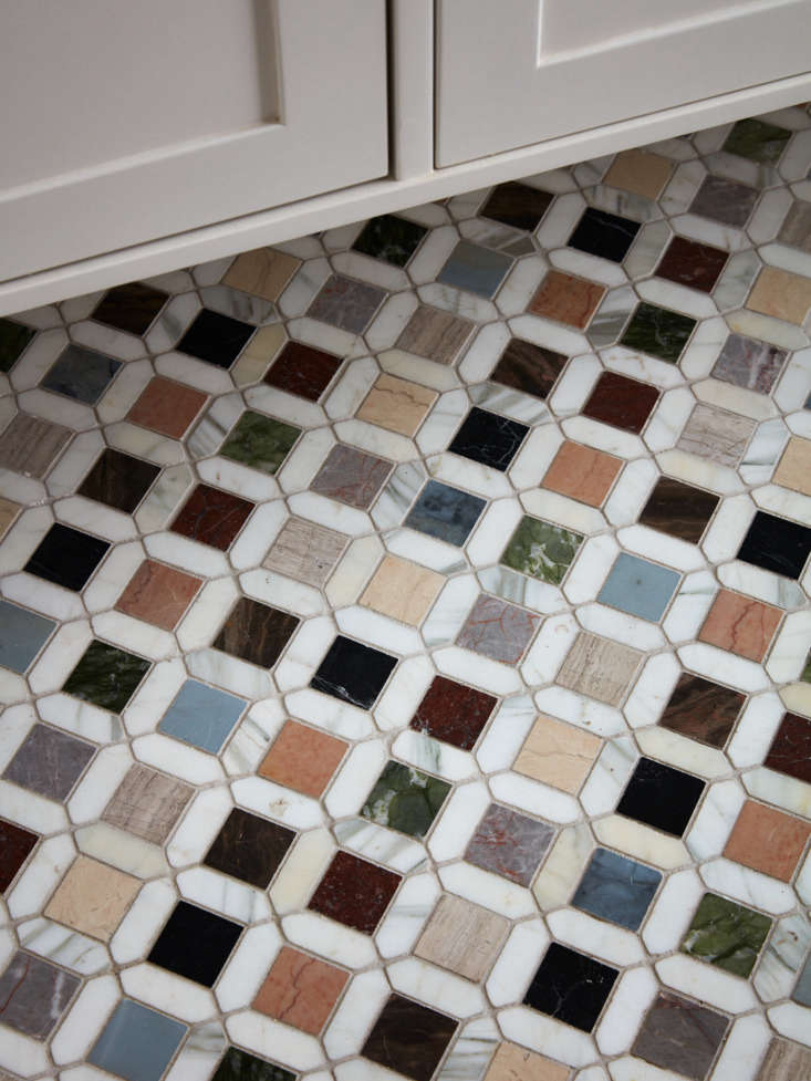 Colored marble tiles glow like gemstones in a bath at Guest Room at luxe Maison de la Luz guesthouse in New Orleans. Photograph by Stephen Kent Johnson.