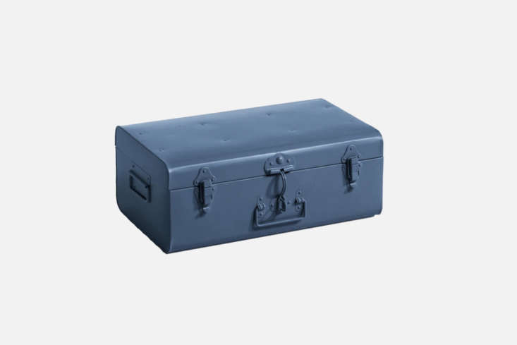 The AM.PM. Baul Metalico Denise, shown in Azul, is a trunk made of colored metal; €55.99 at La Redoute in France. Also available is the larger size for €\15\1.\20 also from La Redoute.