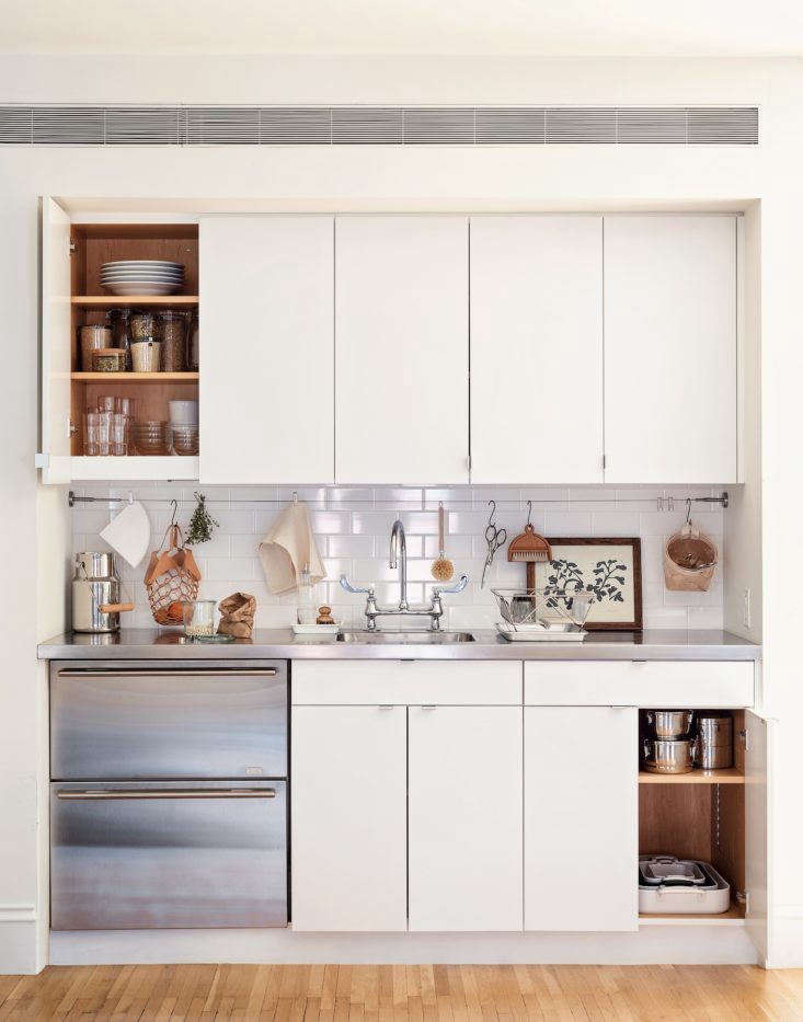 Take a page from this Brooklyn kitchenette and pare down the contents of your kitchen to just the essentials. You don&#8\2\17;t need \10 different pots and pans (in fact, you need only five), and are you ever going to use that Spiralizer? Photograph by Matthew Robbins from Remodelista: The Organized Home. See 5 Space-Saving Ideas to Steal from a Brooklyn Kitchenette, Ikea Hack Included.