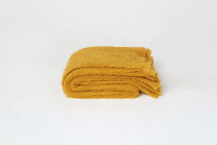AToast Mohair Blanketin Warm Ochre also is available in a darker Tobacco color; \$\295 at Toast in the UK.