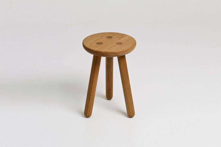 The Another Country Stool One is a three-legged stool in solid oak that is £