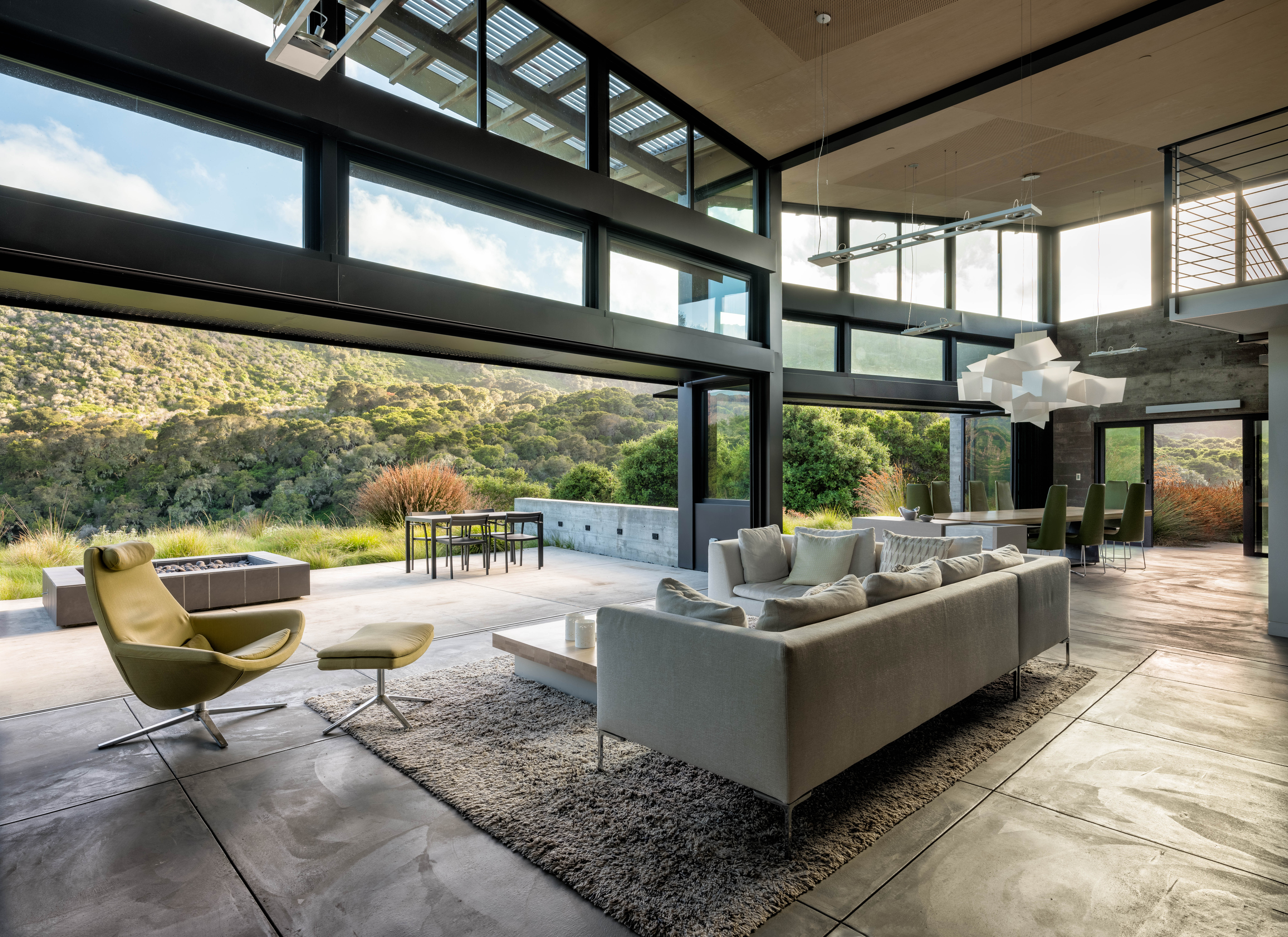 A neutral palette of the house—concrete floors and walls, large glass openings, plywood ceilings, and steel structure—flows from indoors to outdoors, the architects said: &#8\2\20;The use of concrete and large expanses of glass acts as a heat sink, absorbing heat from the sunlight all day and releasing that heat at night.&#8\2\2\1;