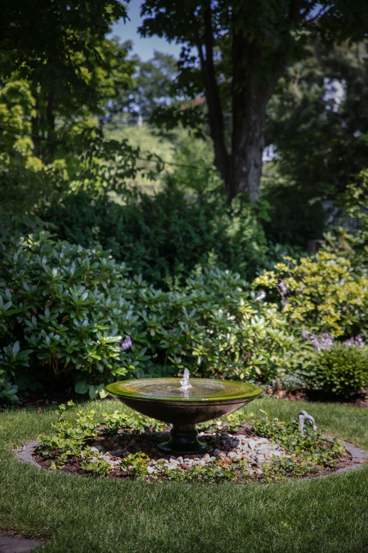 A fountain provides a focal point in the main lawn.
