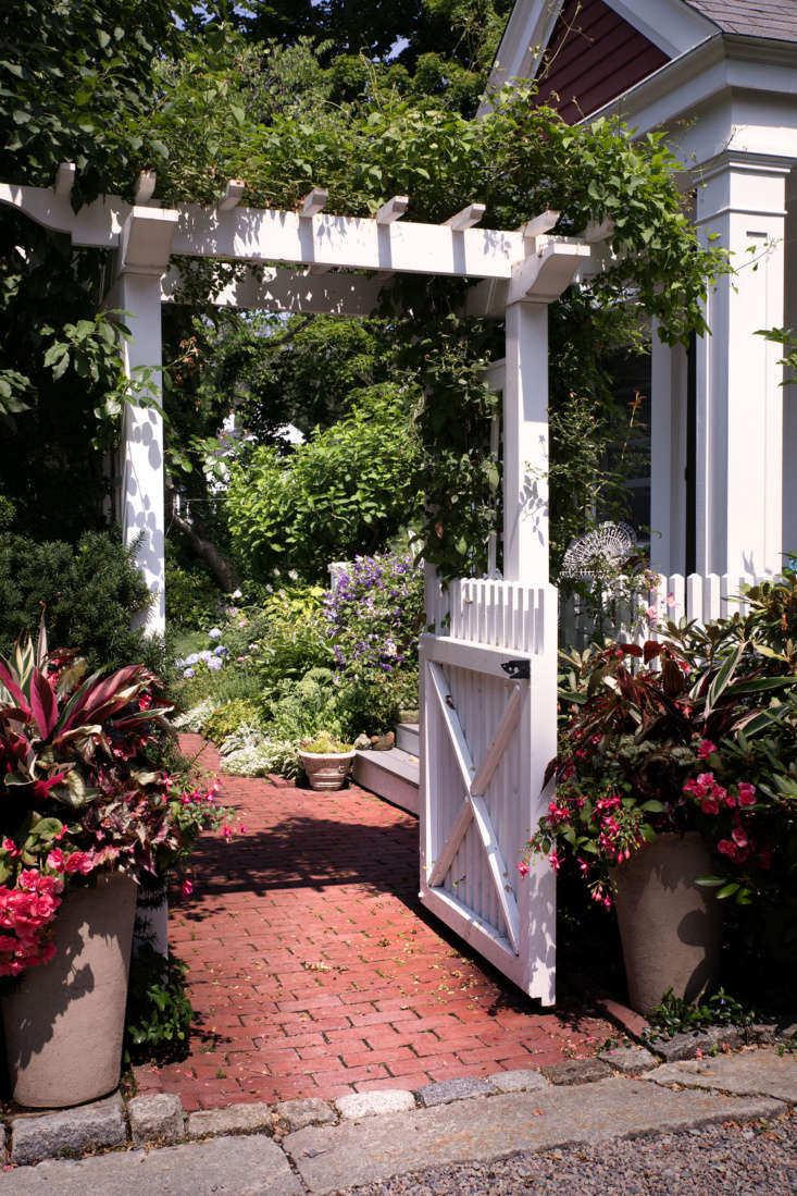 Located at the back of the property, the main garden and outdoor recreation areas are hidden from the road and driveway by the homes as well as flowers, trees, pergolas, and a quaint picket fence. Through one of only several entrances to this secret garden, a historically inspired brick path leads through the garden gate.