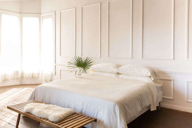 """Oslo is a white that is """"simultaneously subtle and bold,"""" thanks to """"undertones of the palest blue  give depth to the simplest of bedrooms."""""""