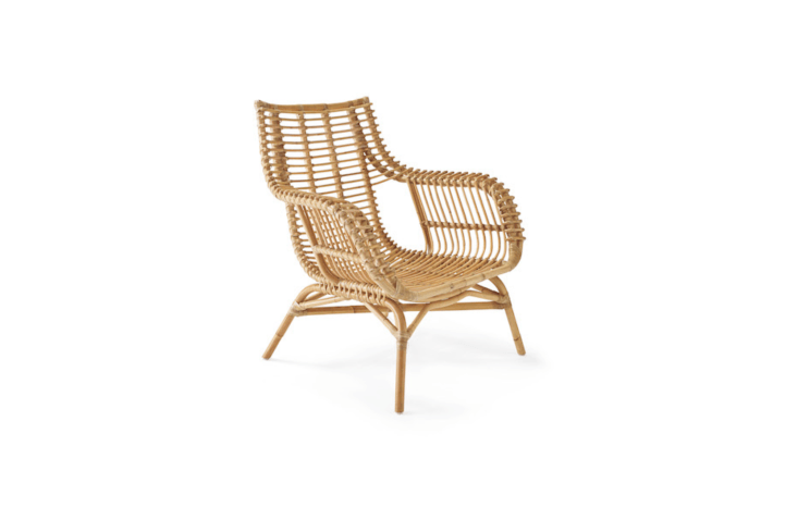 A Venice Rattan Chair with a frame that was steamed and bent into shape by hand is $498 from Serena & Lily.