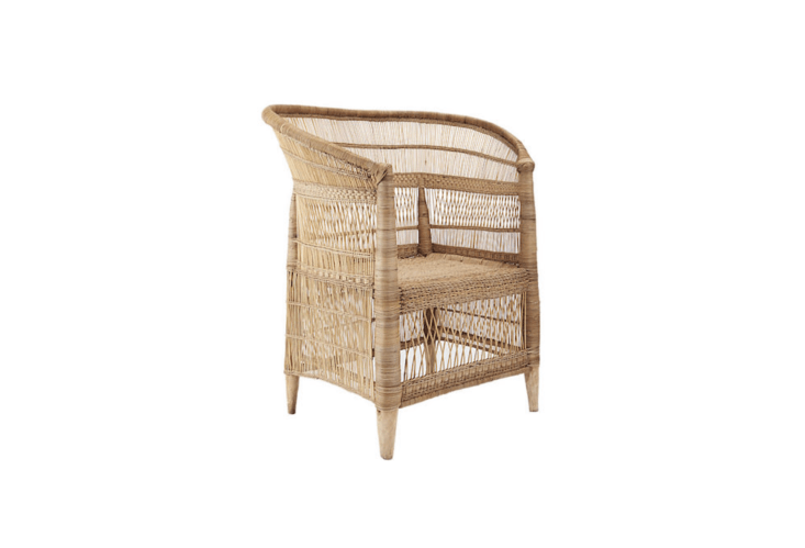 A rattan Woven Malawi Chair is made with bamboo and has a solid blue gum tree wood frame; it is $399 from CB