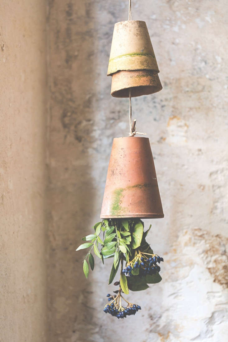 Upside down, terra cotta pots with flowers create a charming, unexpected scene.