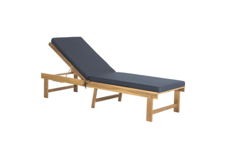 Made by Safavieh, an Inglewood Chaise Lounge Chair is made of acacia wood and comes with a navy blue cushion. It is $3.59 at Home Depot, where the finish on the acacia frame is described as &#8