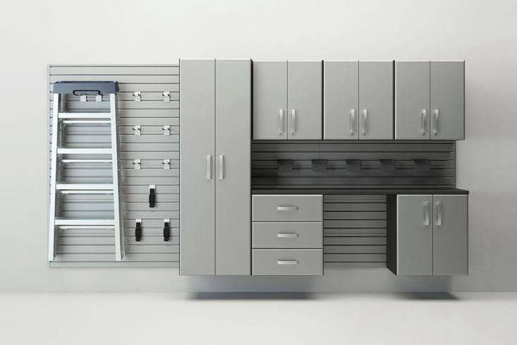 The Flow Wall Silver Garage Storage System is made of gray-painted composite wood and includes six panels, a tall cabinet, three wall cabinets, a base cabinet, drawer cabinet, large work surface, and corresponding brackets and hooks; \$\2,\100 at Lowe&#8\2\17;s.