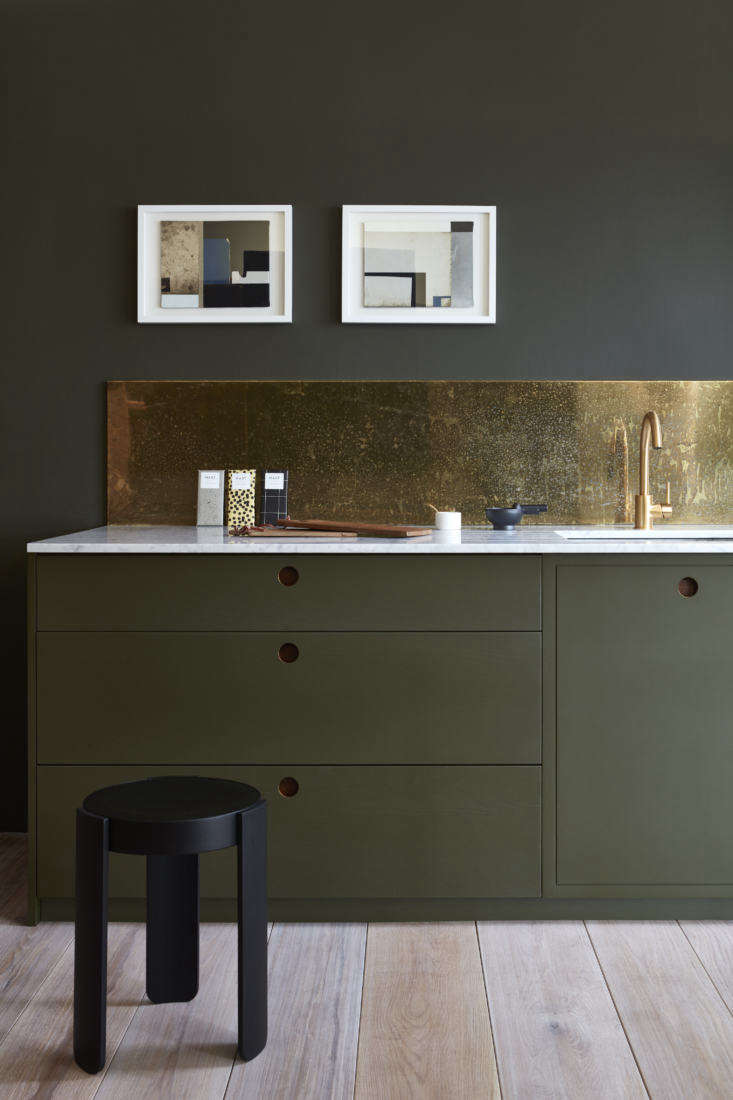 Pre-aged with a hand-applied splatter pattern, a brass backsplash (also shown in the top photograph) &#8\2\20;islacquered with a &#8\2\16;non-porous coating to protect from continued tarnishing and fix the patina.'&#8\2\2\1; writes Margot.Photography courtesy of Naked Kitchens.