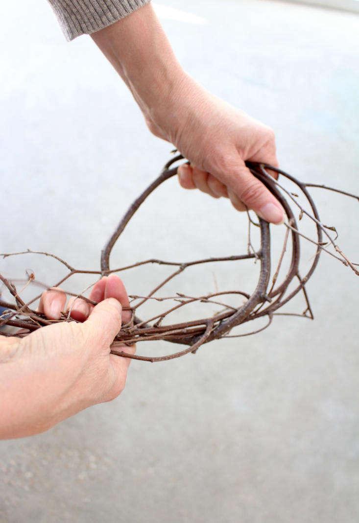 Winding a pliable branch into a circular knot.