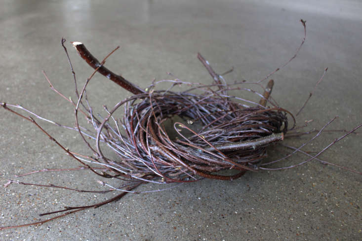 Four solid twig butts protrude like the points of a compass indicating that the first stage is finished.