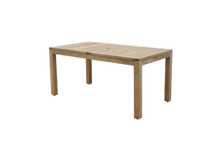 A 63-inch-long slatted teak Saldano Dining Table with an umbrella hole seats six and is \$\1,079 at Pottery Barn.