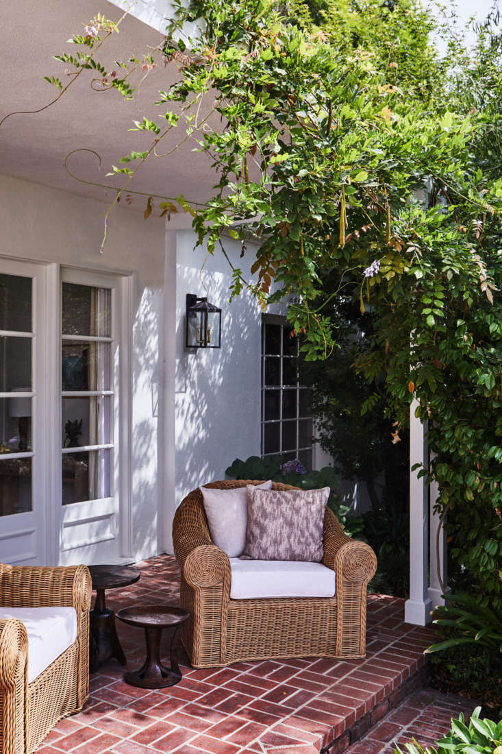 A must for any summertime outdoor gathering is shade. This sheltered terrace of a \1930s house in Los Angeles would be the perfect spot to shoot the breeze with guests. Photograph by Sam Frost, courtesy of DISC Interiors, from LA Palette Cleanser: A Flash-Free Holmby Hills Makeover by DISC Interiors, Before and After.