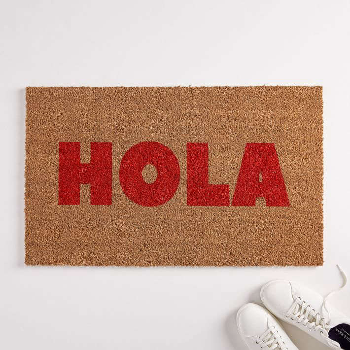 The Hola Doormat, also hand-painted by Nickel Designs, is definitely not understated, but we like the bold, simple typography; \$44.