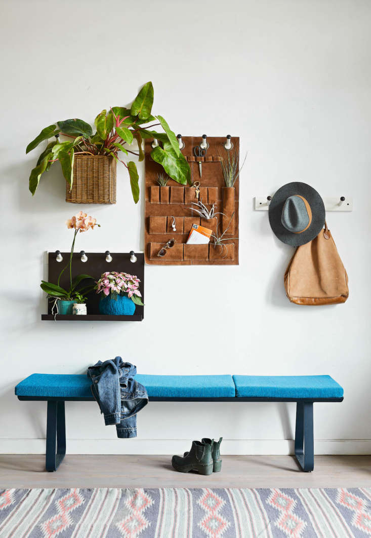 &#8\2\20;The system shown , created with a combination of wall-mounted pieces found at Pottery Barn, has a cohesive overall look thanks to a unifying color palette of blues, browns, and pinks that runs through the plants, vases, and accessories,&#8\2\2\1; writes Chapman.
