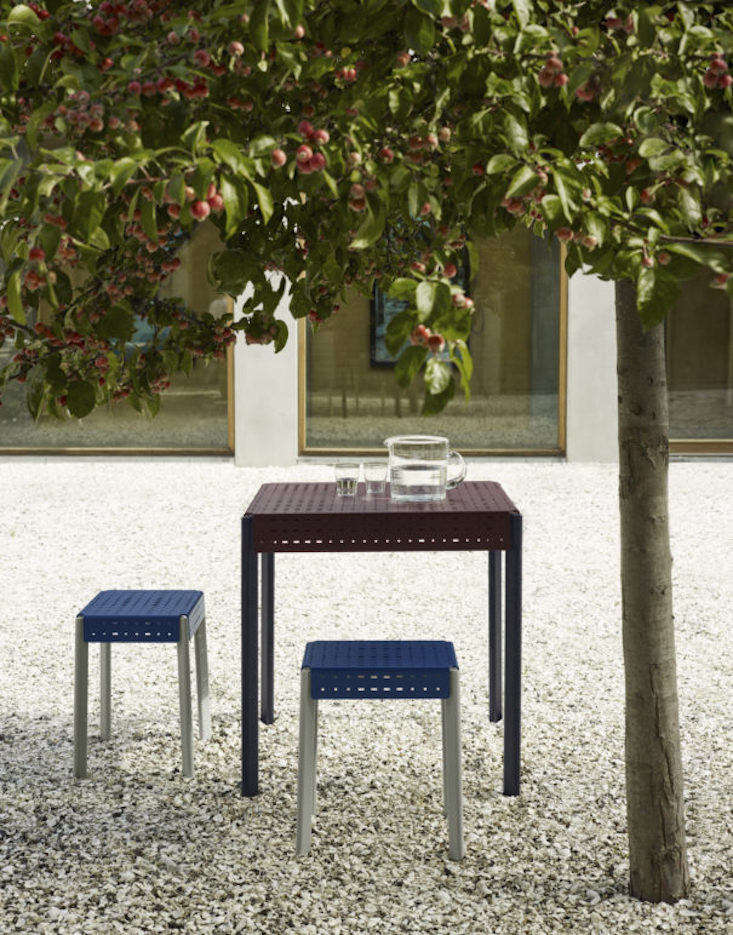 The aluminum Gerda table and stools were designed by Included Middle, a collaboration between a furniture designer and a textiles designer. The collection was inspired and named after Danish textiles artist Gerda Henning.