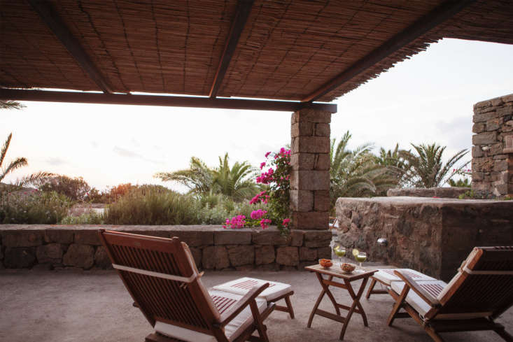 Not every outdoor space is going to have the views that Tenuta Borgia has, but a well-placed flowering shrub, like this bright bougainvillea, does wonders for lifting moods. To see the rest of this beautiful rental, see Vacation Dreaming: Elegant Simplicity on the Italian Island of Pantelleria.