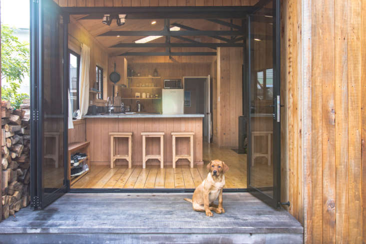 Double-glazed bifold doors open the living area to the deck in this New Zealand home. Photograph courtesy of George & Willy, from The DIY Makeover: George and Willy's Urban Cabin (Created from a Tiny 9loading=