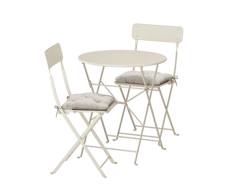 A must for small balconies, the powder-coated SALTHOLMEN tables and chairs, in beige, fold up for easy storage; \$90.98.