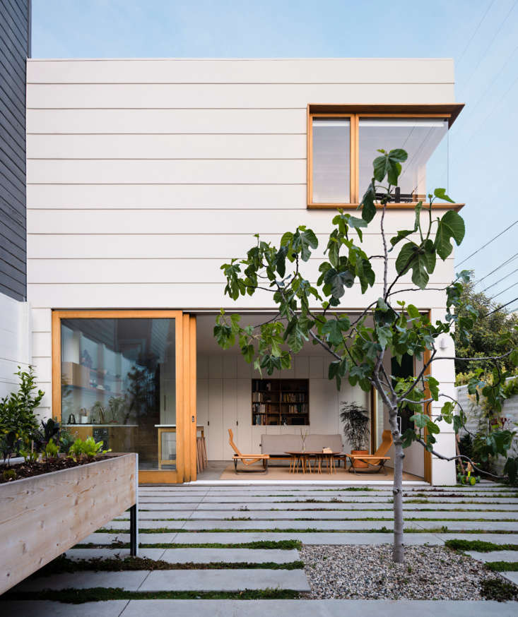Concrete floors in the interior dissolve into concrete pavers in the courtyard of this project by SF-based architect Ryan Leidner. Photograph by Joe Fletcher, courtesy of Ryan Leidner Architecture, from Two for One: A Courtyard Connects Old and New in a San Francisco Home.