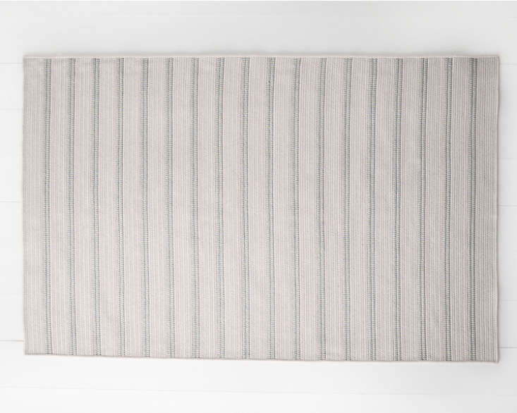 Sunbrella&#8\2\17;s Indoor Outdoor Braided Striped Rug, shown in seafoam, has an old-school lake house vibe; \$\148 to \$\1,898 at Garnet Hill.