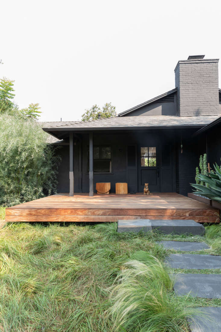 The dark painted exterior is a nod to the age-old Japanese practice of shou sugi ban. Photograph by Ye Rin Mok, from Creative Spaces, from LA Noir: Architect Takashi Yanai's Humble-Chic Bungalow.
